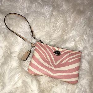 Coach wrist purse. Pink/white zebra design.